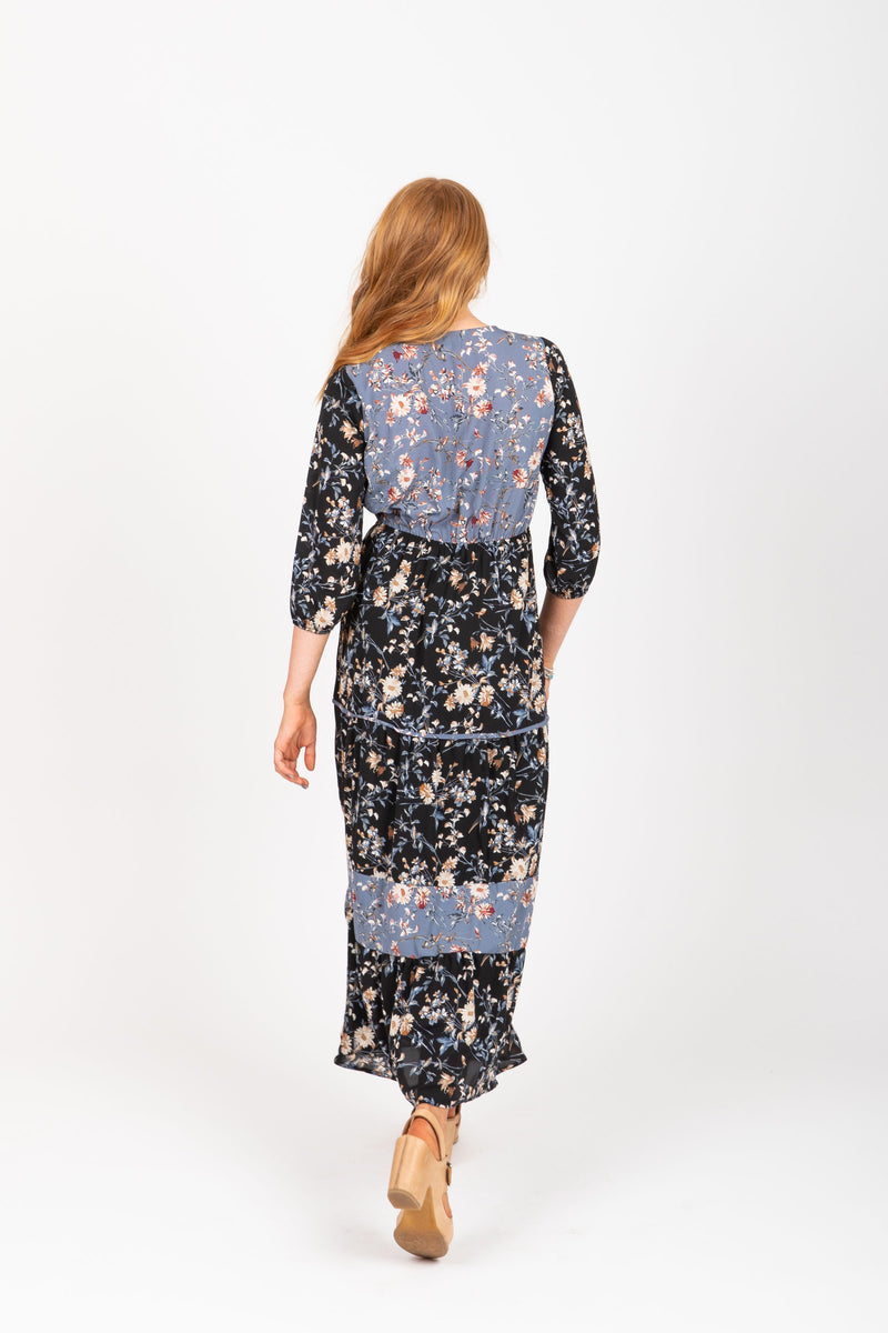The Haskell Floral Contrast Maxi Dress in Black, studio shoot; back view