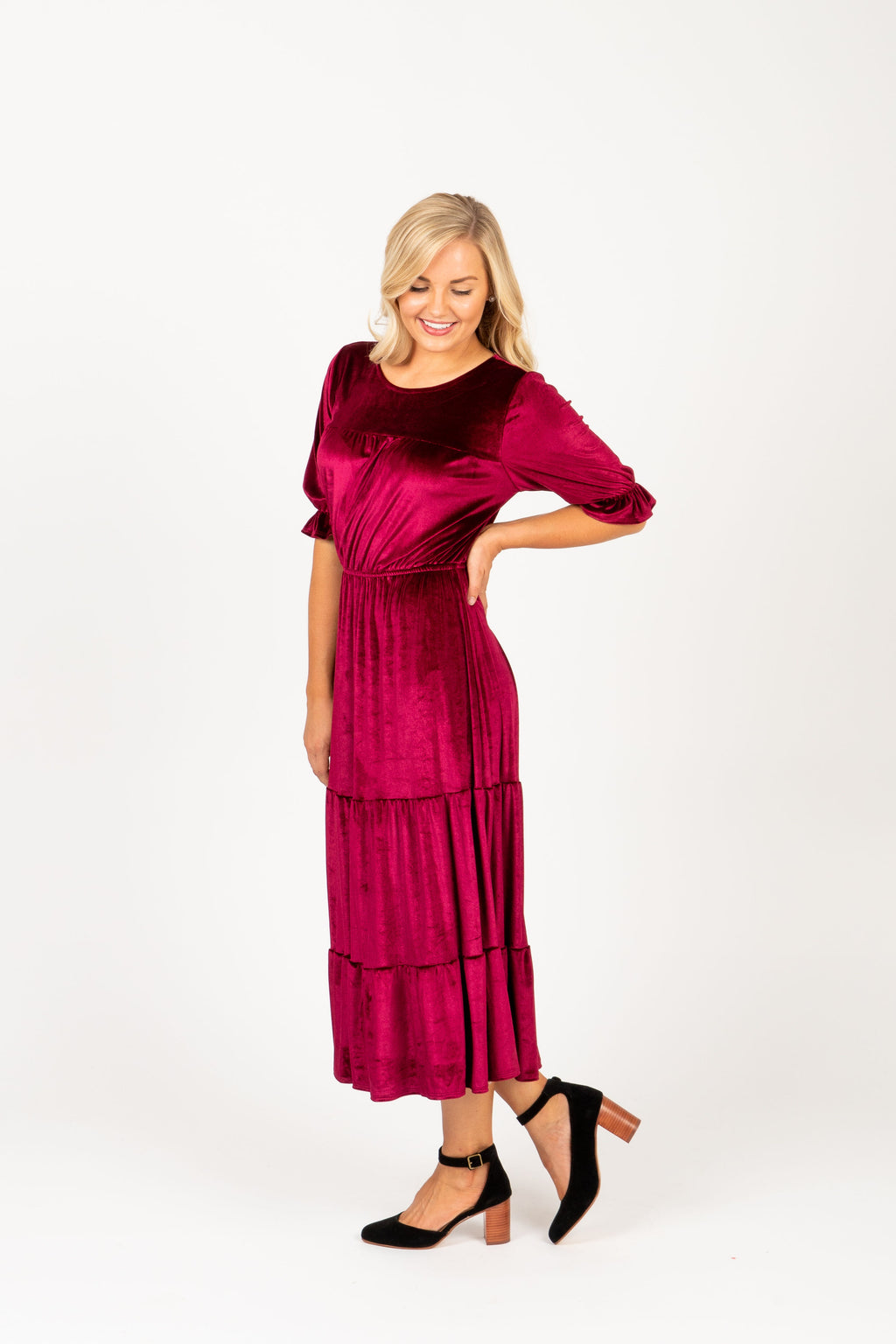 The Beti Teired Velvet Dress in Plum, studio shoot; front view