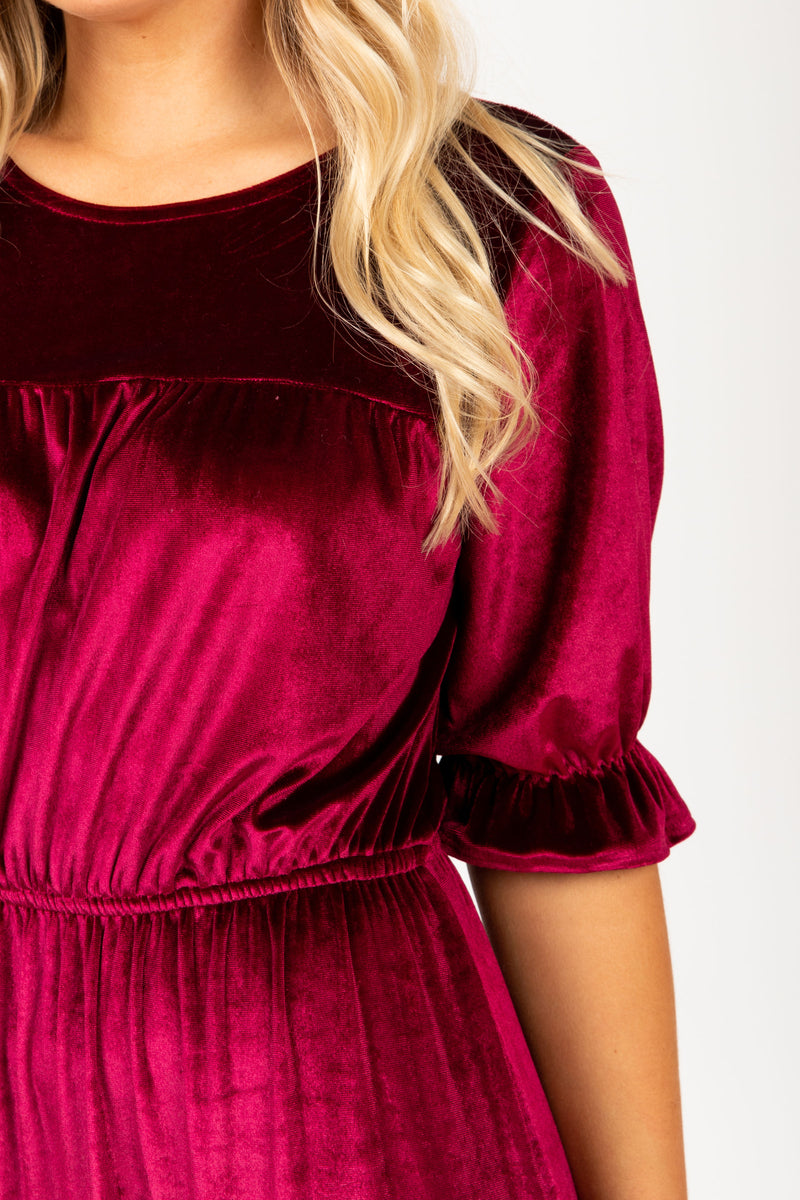 The Beti Teired Velvet Dress in Plum, studio shoot; closer up front view