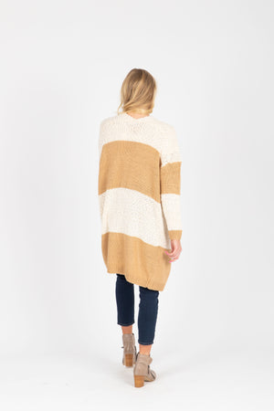 The Annelle Block Cardigan in Tan, studio shoot; back view