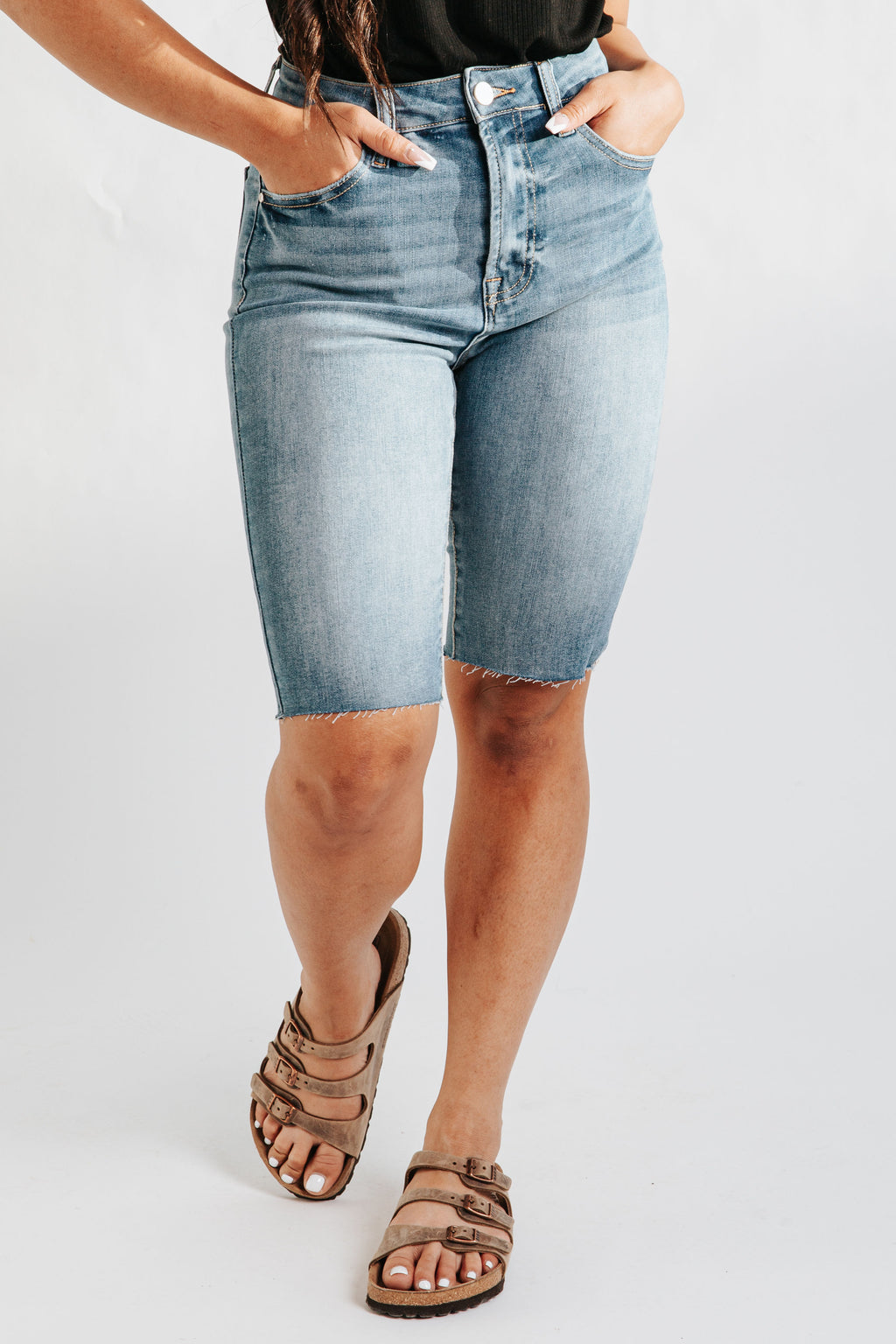 The Ashburn High Rise Denim Biker Short in Dark Wash, studio shoot; front view