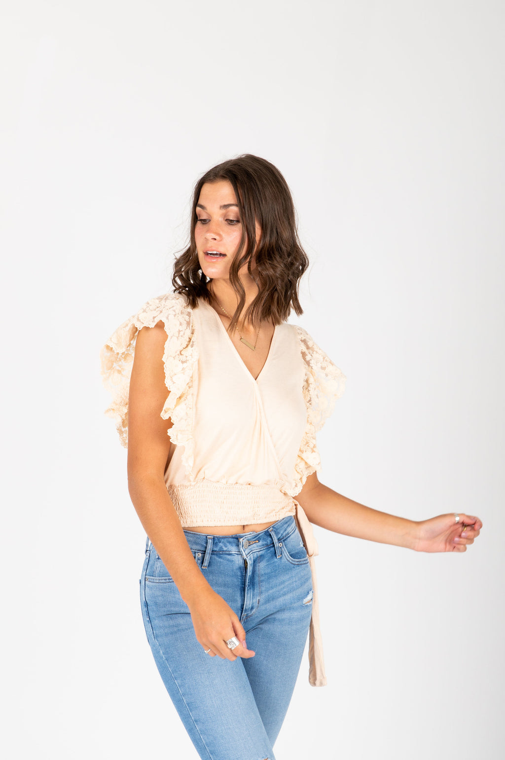 The Remy Lace Tie Blouse in Cream, studio shot; front view