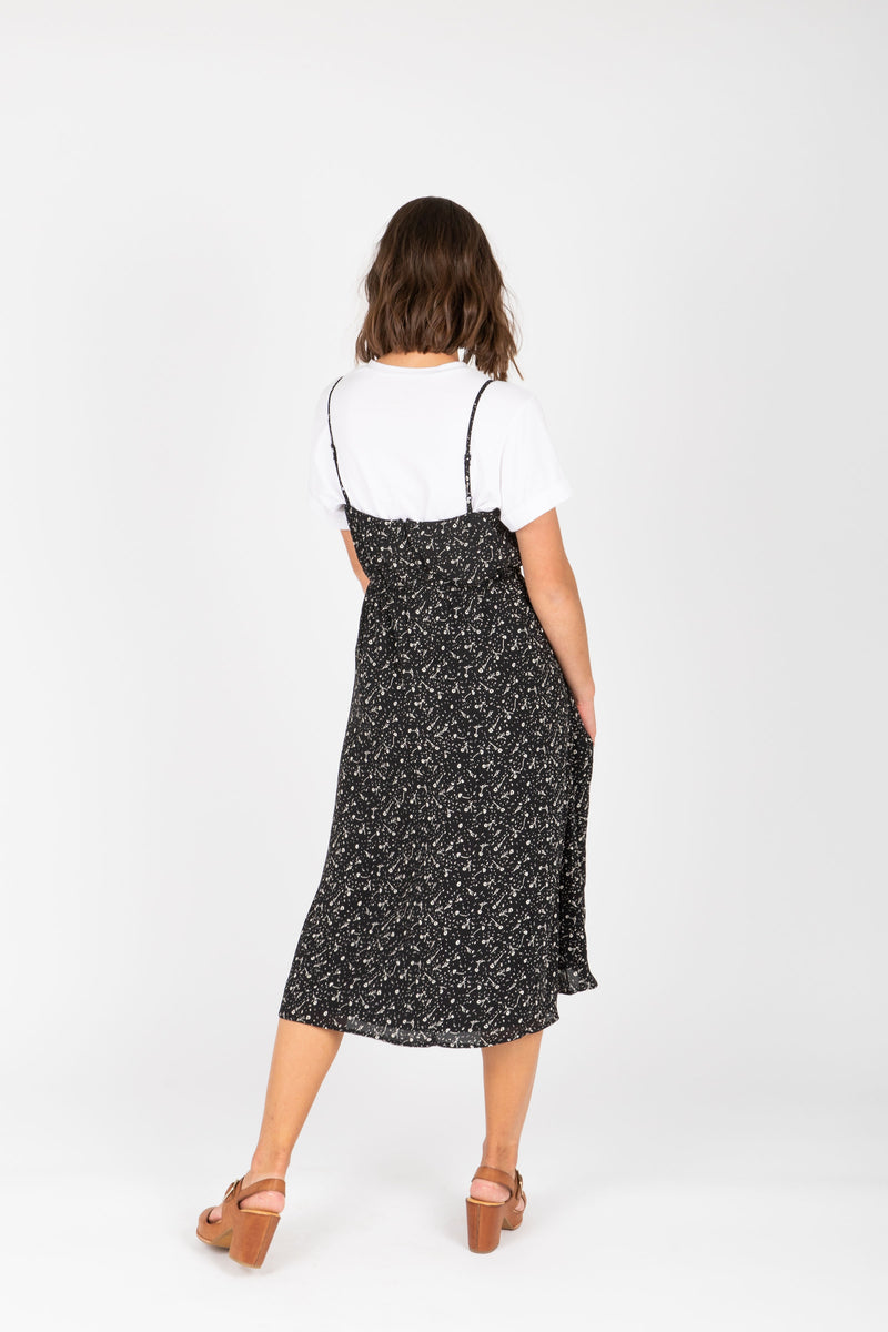 The Millie Patterned Tank Dress in Black, studio shoot; back view