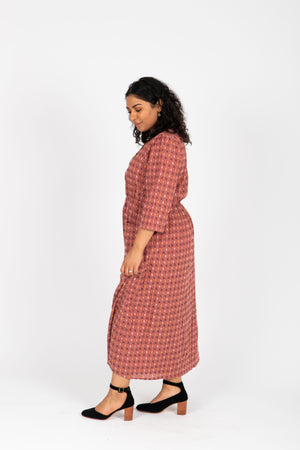 The Vivid Check Tiered Maxi Dress in Mauve, studio shoot; side view