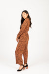 The Alter Collared Animal Print Jumpsuit in Camel, studio shoot; side view