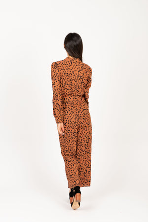 The Alter Collared Animal Print Jumpsuit in Camel, studio shoot; back view