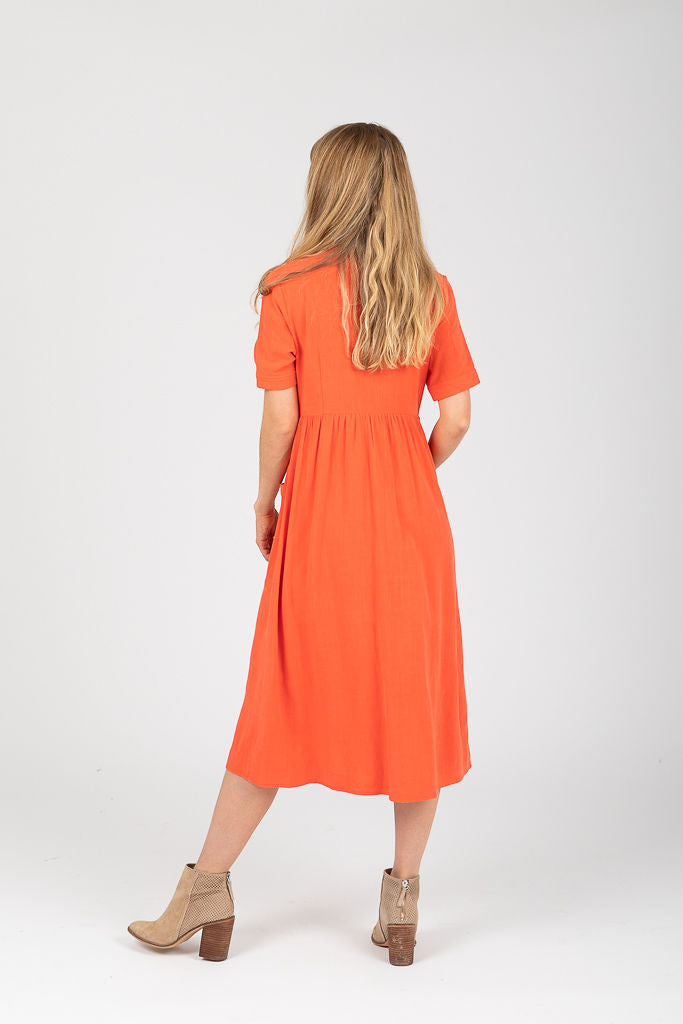 The Toledo Button Pocket Dress in Coral