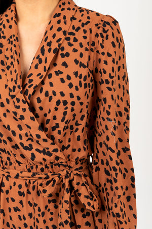 The Alter Collared Animal Print Jumpsuit in Camel, studio shoot; closer up front view