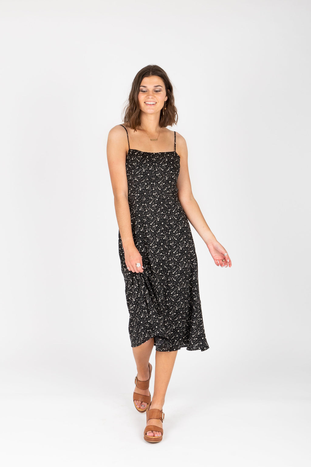The Millie Patterned Tank Dress in Black, studio shoot; front view