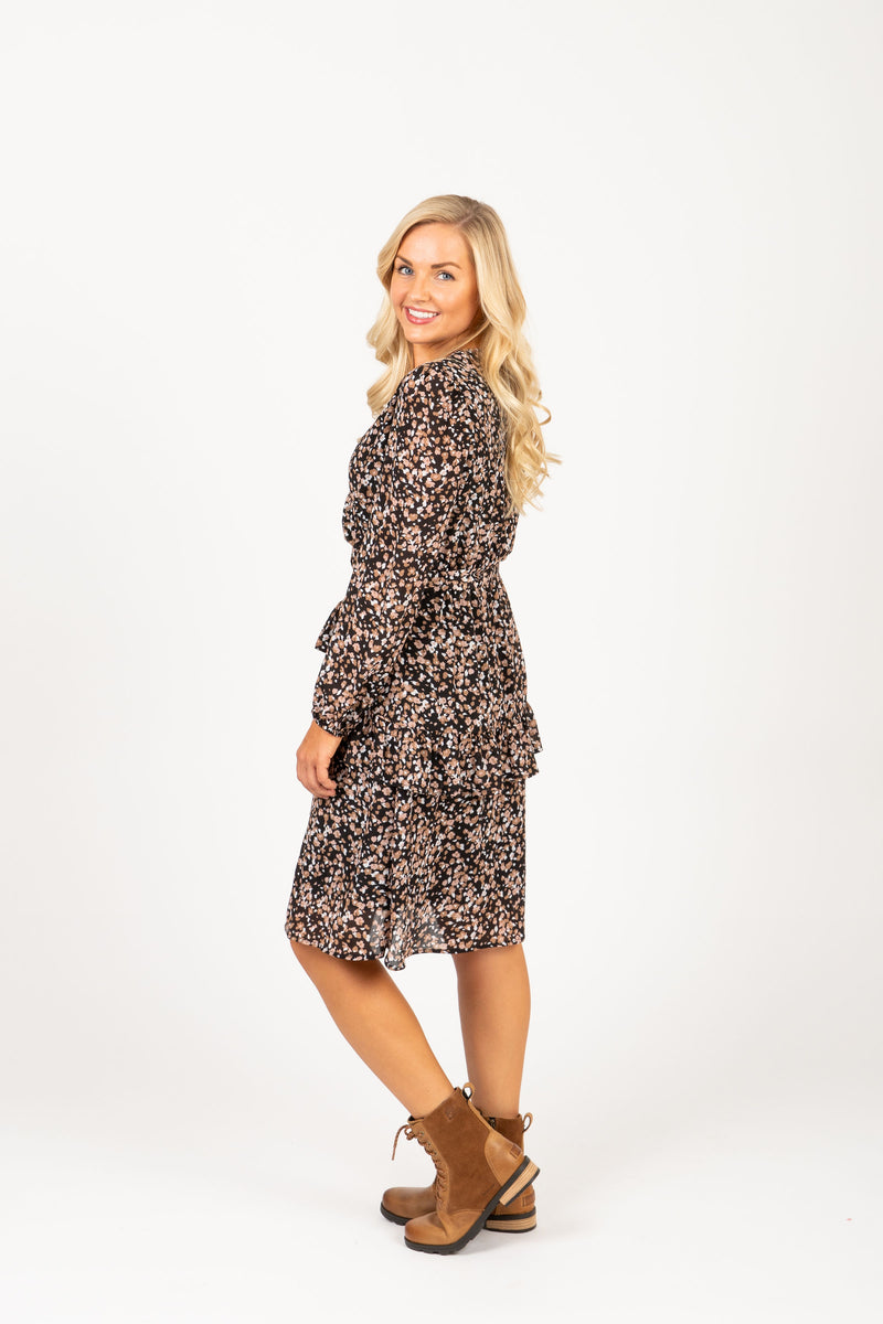 The Resille Patterned Ruffle Dress in Black, studio shoot; side view