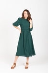 The Ezra Smocked Midi Dress in Hunter Green, studio shoot; front view