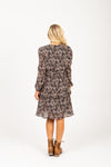 The Resille Patterned Ruffle Dress in Black, studio shoot; back view