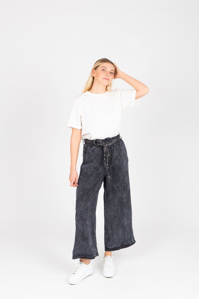 The Fei Casual Trousers in Faded Black, studio shoot; front view