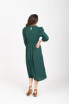 The Ezra Smocked Midi Dress in Hunter Green, studio shoot; back view