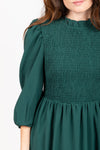 The Ezra Smocked Midi Dress in Hunter Green, studio shoot; closer up front view