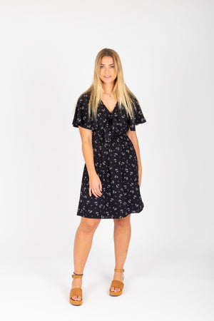 , The Heidi Floral Neck Tie Dress in Black, studio shoot; front view