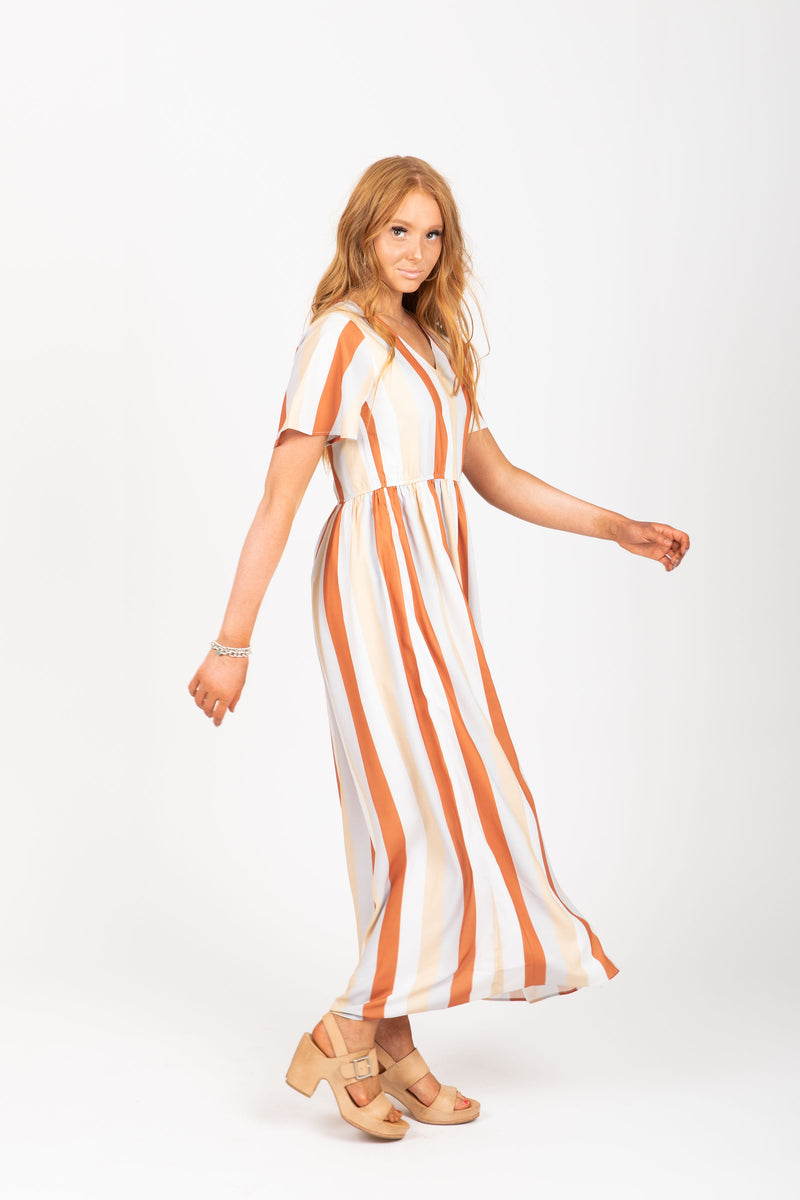 The Butler Striped Maxi Dress in Multi, studio shoot; side view