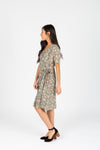 Piper & Scoot: The Alora Floral Wrap Dress in Sage, studio shoot; side view