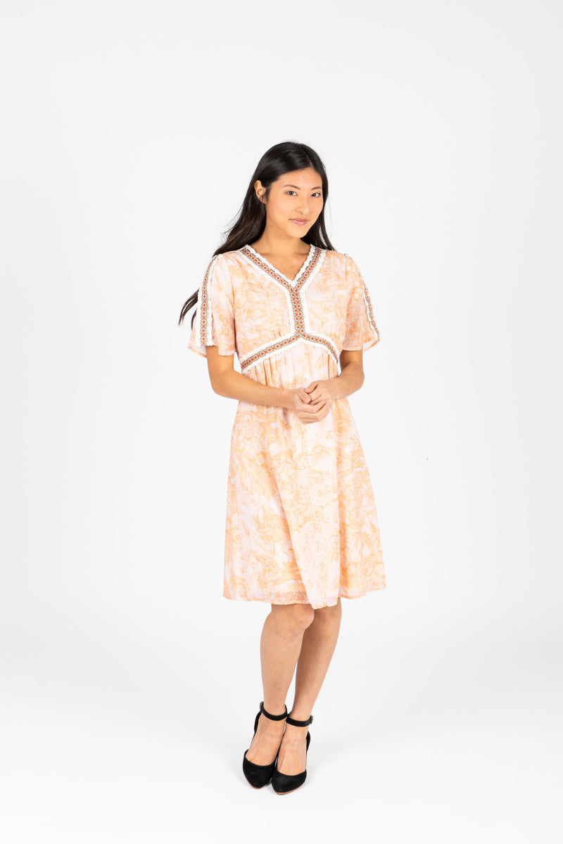 Piper & Scoot: The Kenley Detail Empire Dress in Peach, studio shoot; front view