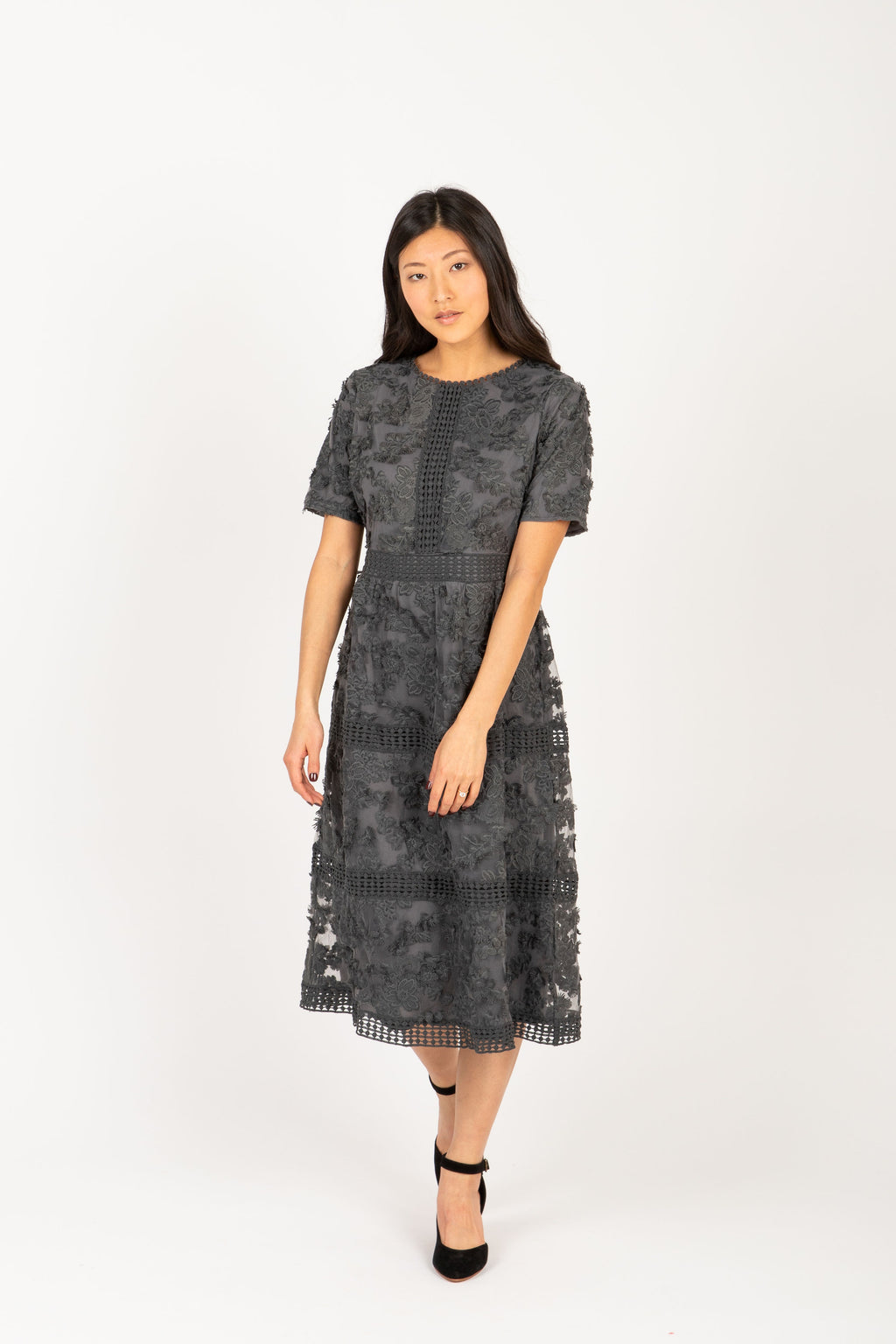 Piper & Scoot: The Ultimate Lace Detail Dress In Charcoal, studio shoot; front view