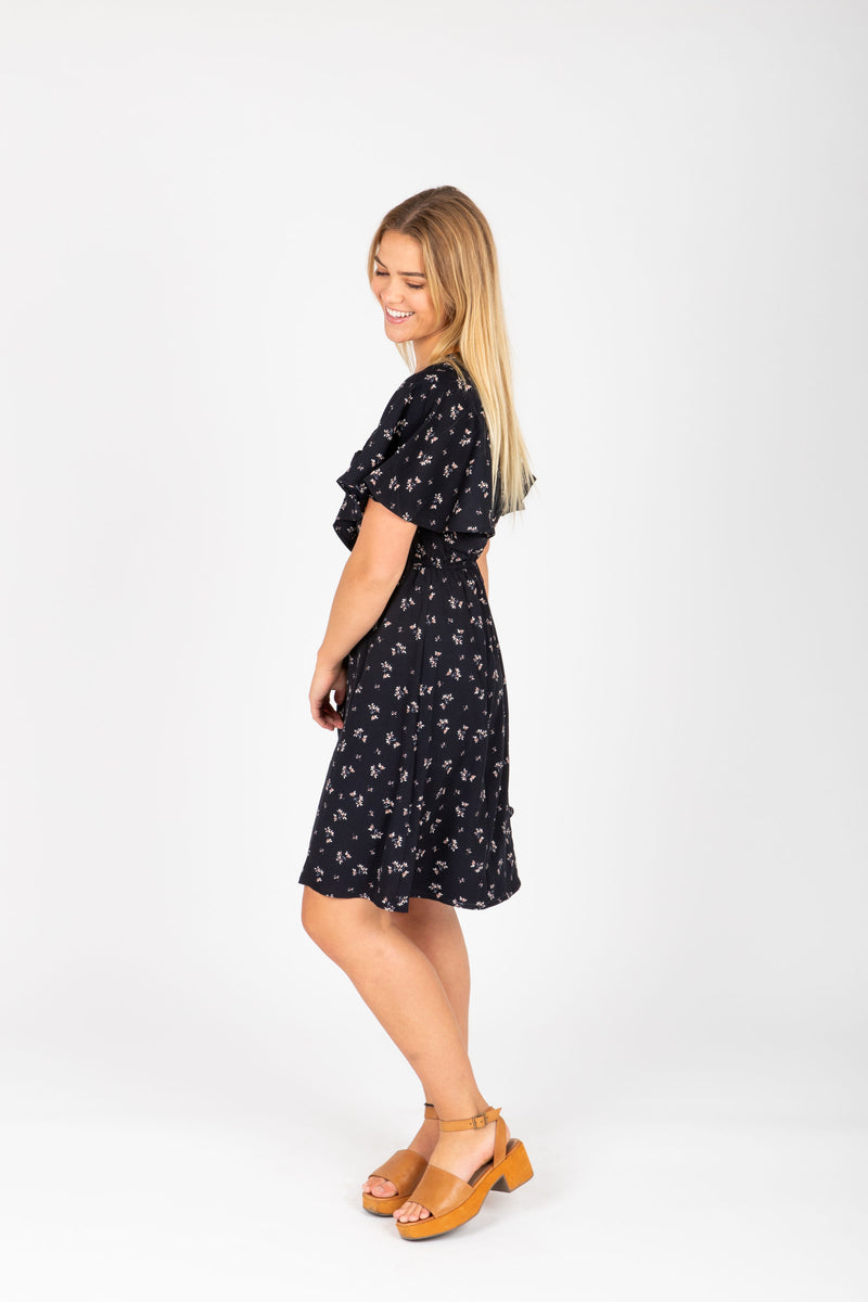 , The Heidi Floral Neck Tie Dress in Black, studio shoot; side view