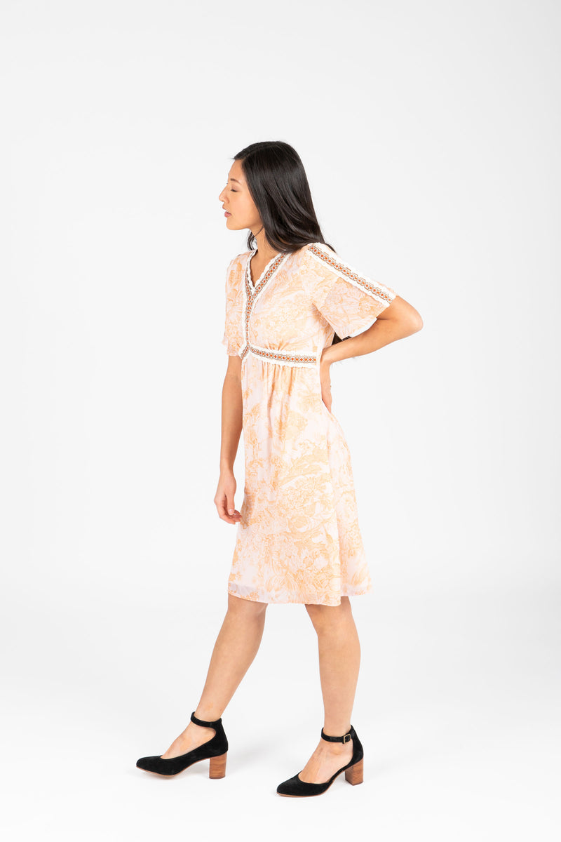 Piper & Scoot: The Kenley Detail Empire Dress in Peach, studio shoot; side view