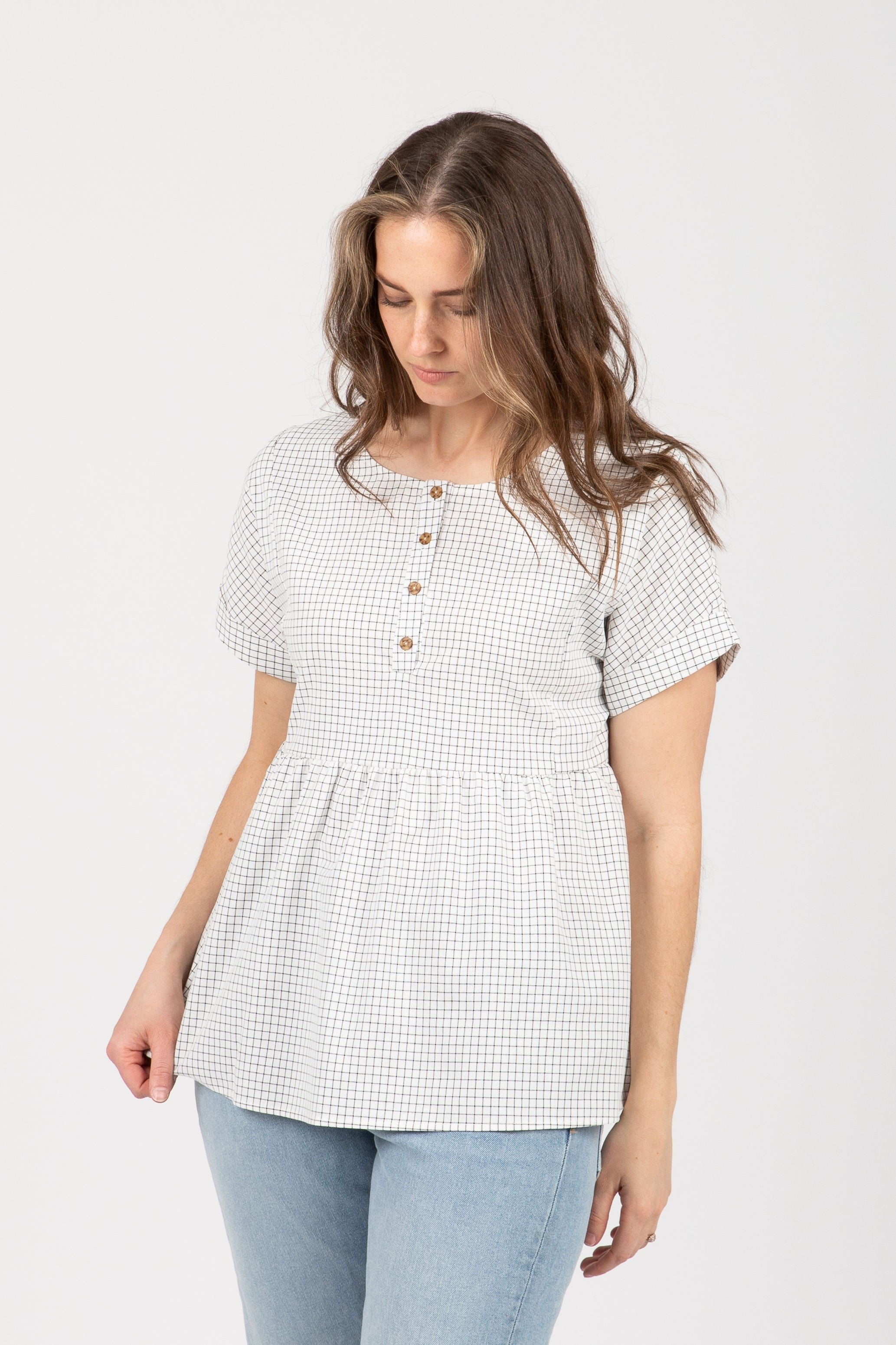 The Heartbeat Grid Button Peplum in White
