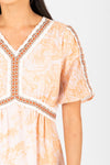 Piper & Scoot: The Kenley Detail Empire Dress in Peach, studio shoot; closer up front view