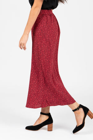 The Fran Patterned Midi Skirt in Red, studio shoot; side view