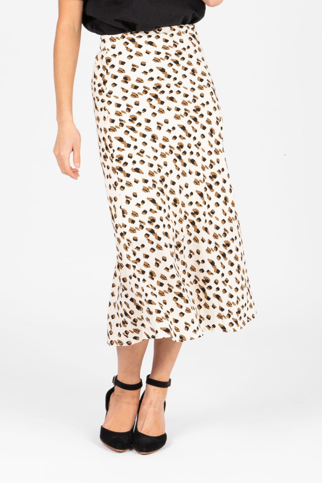 The Nana Patterned Midi Slip Skirt in Cream, studio shoot; front view