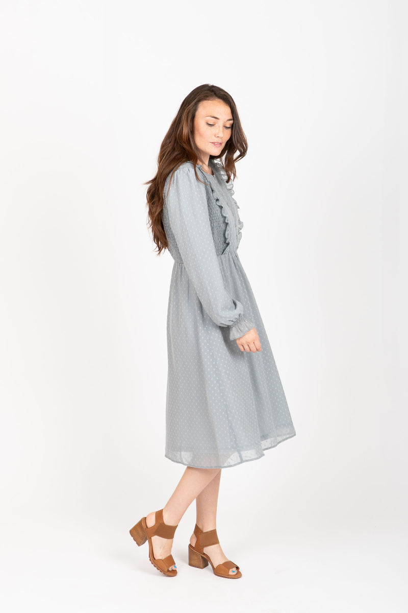 The Branly Ruffle Bib Dress in Sage, studio shoot; side view