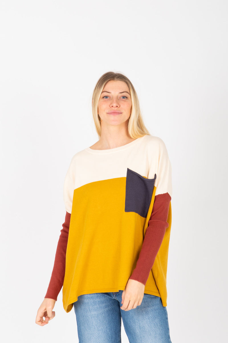 The Bobbi Casual Pocket Sweater in Mustard, studio shoot; front view