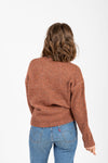 The Lean Speckled Mock Neck Sweater in Camel, studio shoot; back view