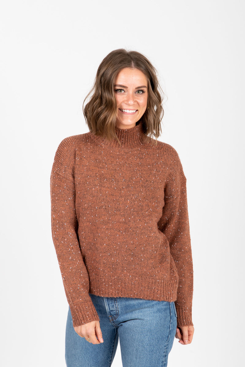 The Lean Speckled Mock Neck Sweater in Camel, studio shoot; front view