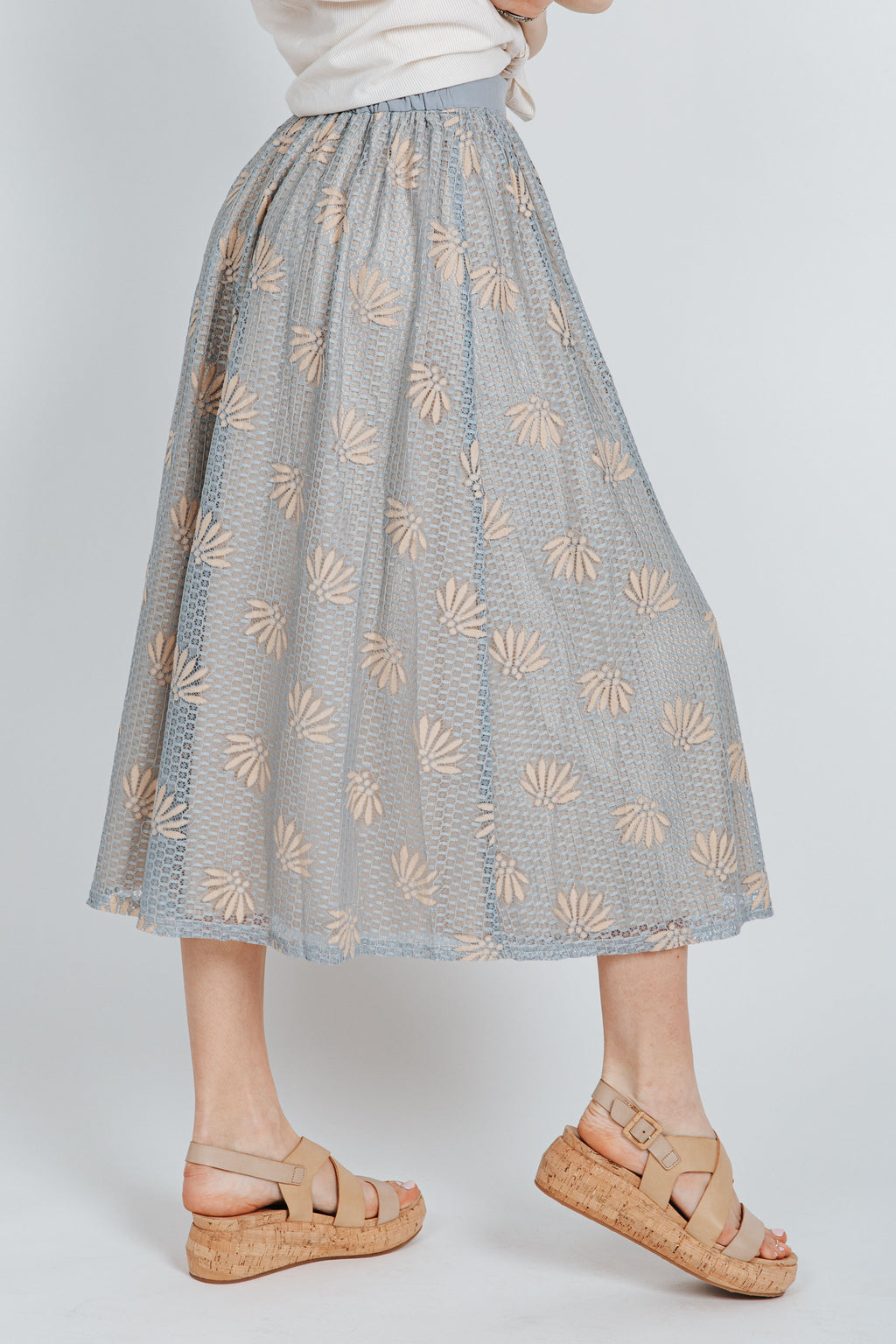 The Alexis Lace Skirt in Dusty Blue, studio shoot; side view