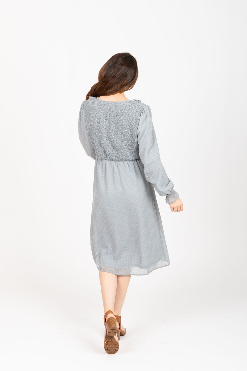 The Branly Ruffle Bib Dress in Sage, studio shoot; back view