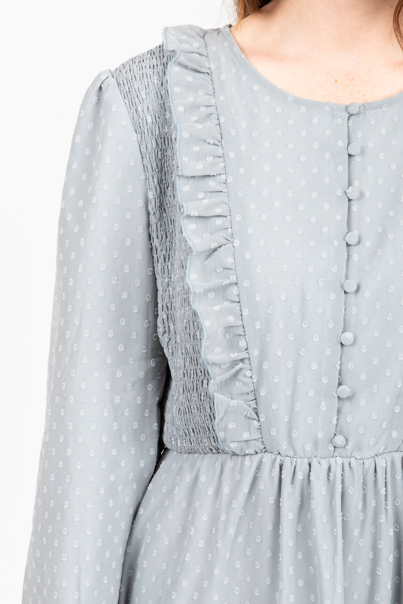 The Branly Ruffle Bib Dress in Sage, studio shoot; closer up front view