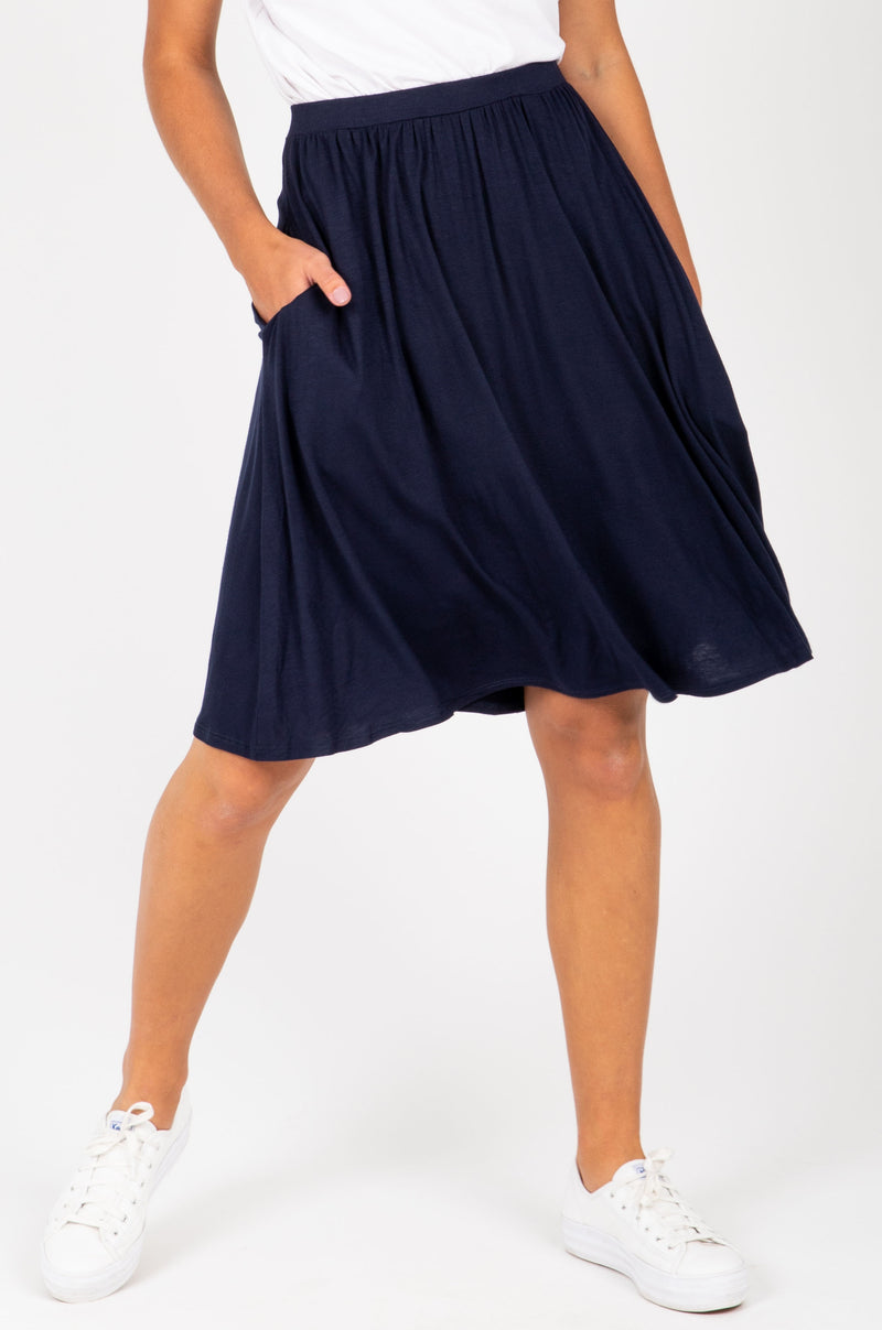 The Kolton Casual Jersey Skirt in Navy, studio shoot; front view