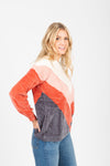 The Fawcett V Striped Sweater in Rust, studio shoot; side view