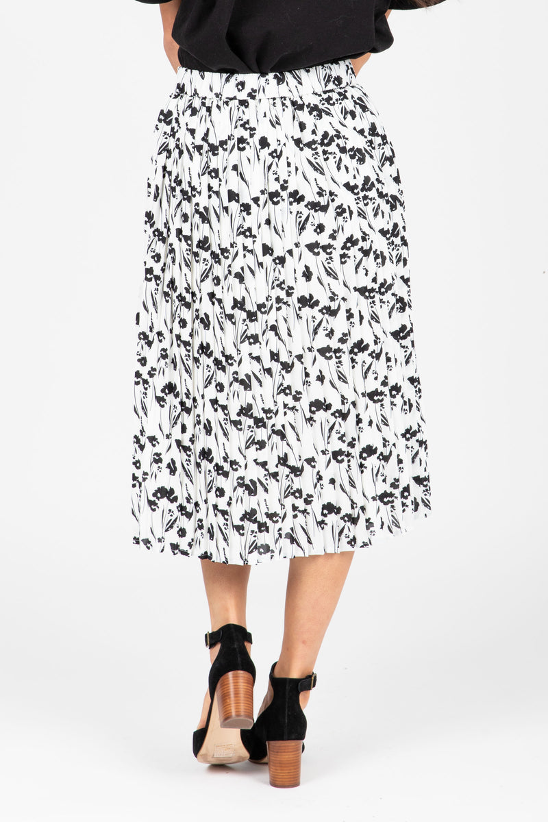 The Willa Floral Pleated Skirt in White, studio shoot; back view