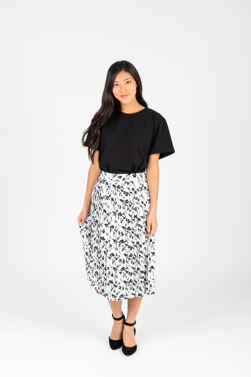 The Willa Floral Pleated Skirt in White, studio shoot; front view