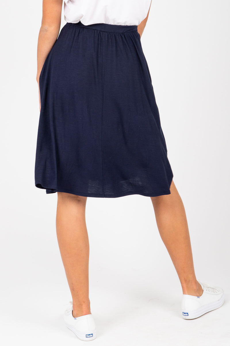 The Kolton Casual Jersey Skirt in Navy, studio shoot; back view