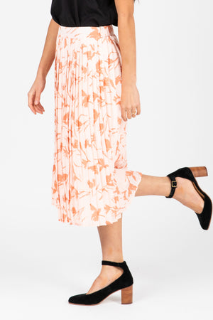 The Jenna Floral Pleated Skirt in Blush, studio shoot; side view