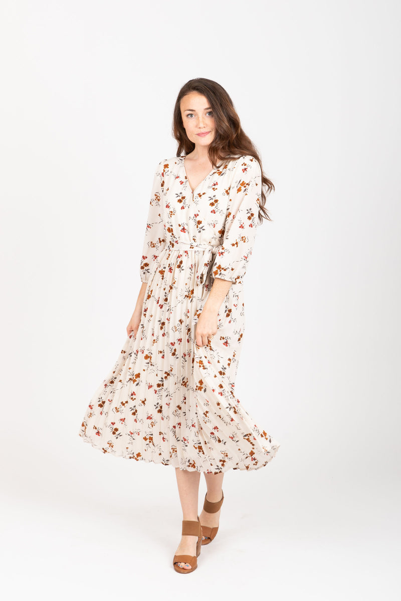 The Watts Floral Pleated Wrap Dress in Ivory, studio shoot; front view