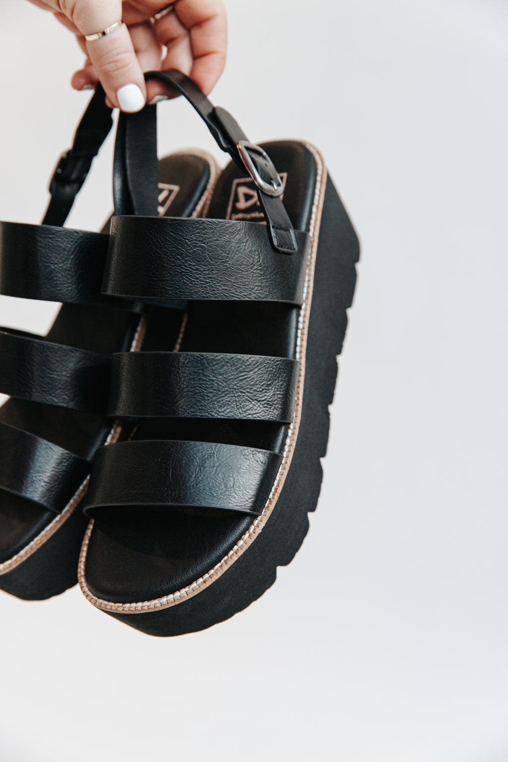 Chinese Laundry: The Pendulum Platform Strap Sandal in Black, studio shoot; side view