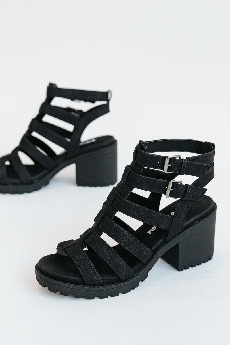 Chinese Laundry: The Fun Stuff Buckle Sandal in Black, studio shoot; side view