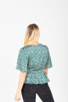 The Jolie Dot Wrap Blouse in Jewel Green, studio shoot; back view