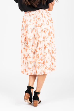 The Jenna Floral Pleated Skirt in Blush, studio shoot; back view
