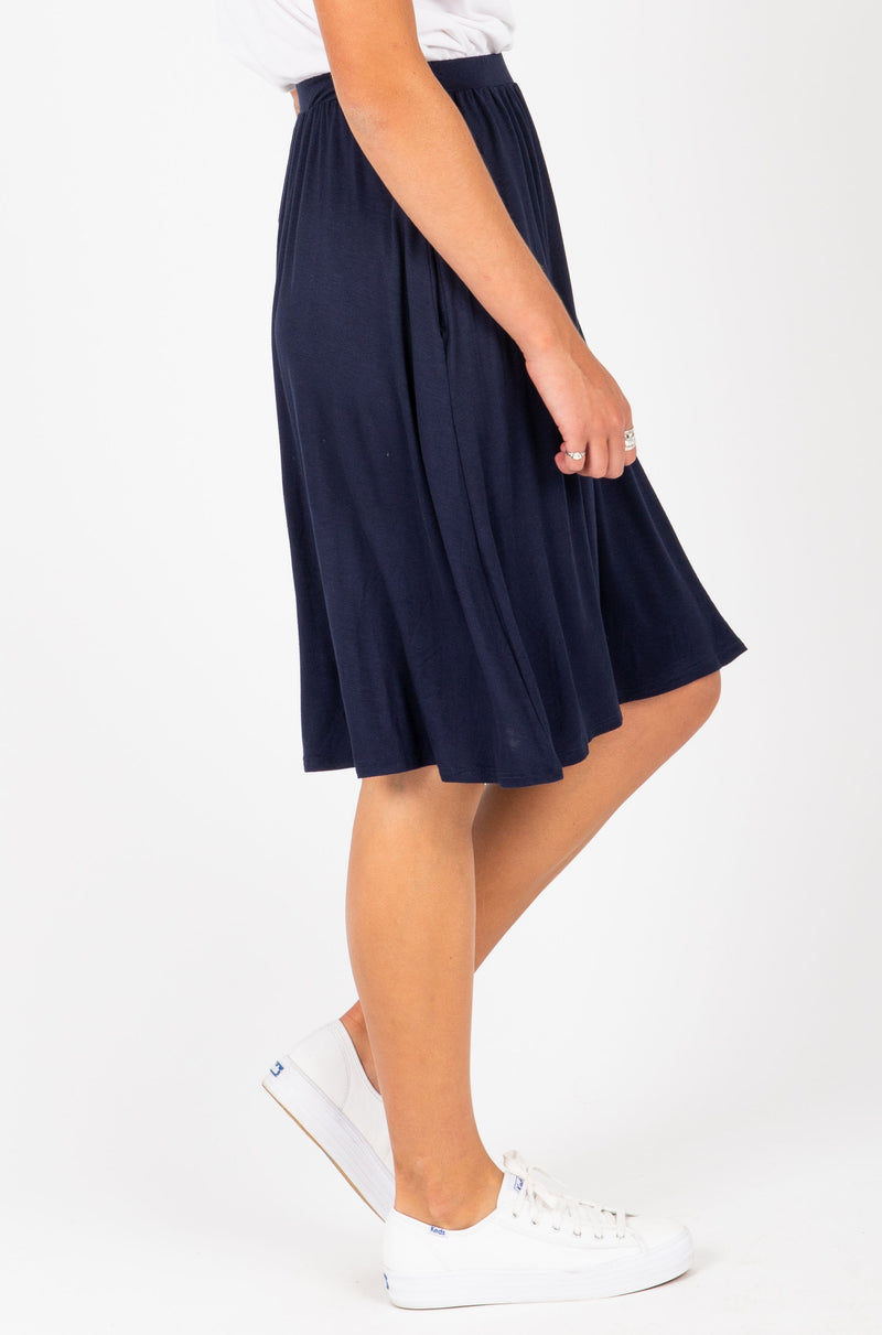 The Kolton Casual Jersey Skirt in Navy, studio shoot; side view