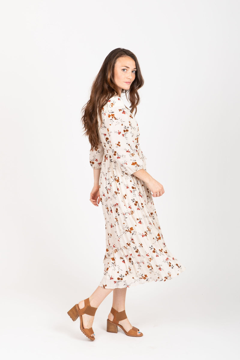The Watts Floral Pleated Wrap Dress in Ivory, studio shoot; side view